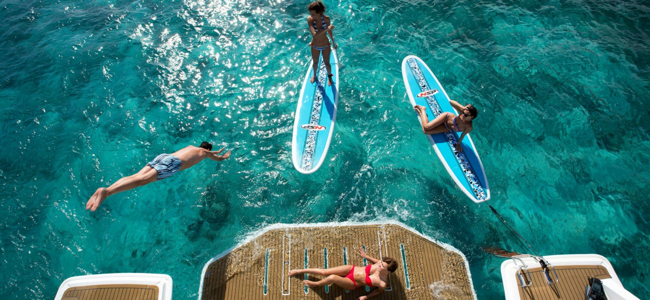 Sup paddling water fun yacht play sailing catamaran seychelles cat luxury holidays charter